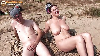 Real amateur threesome on the beach