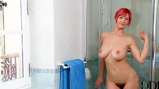 Vanessa is a curvy Polish babe with great big boobs. She takes off her cotton panties and displays her hairy snatch before taking a shower. Hot bodied busty redhead shows off her assets under the shower willingly!