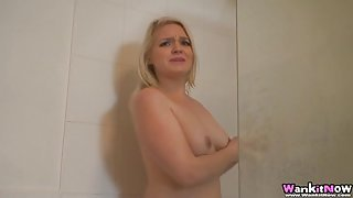 Spy on the curvy girl with a bush as she showers