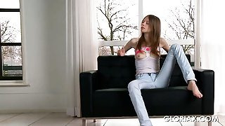 Gloria in tight jeans teasing herself by the window