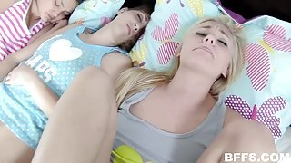 Her friends sleep as this blonde teen gets fucked